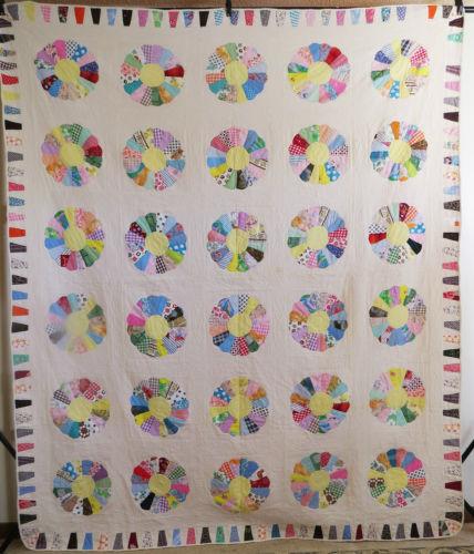 http://www.ebay.com/itm/Vintage-Antique-Handmade-Quilt-Dresden-Plate-Applique-Quilt-Great-Textiles-/122039931239?hash=item1c6a259167:g:rW0AAOSwvgdW1ziP